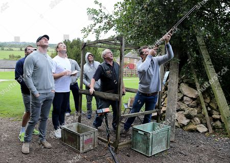 Ireland's Peter O'Mahony, watched by Paul O'Connell, Jared Payne, Darren Cave, Jamie Heaslip and Jack McGrath, clay pigeon shooting during a down day today
