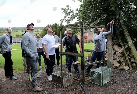 Ireland's Peter O'Mahony, watched by Devin Toner, Paul O'Connell, Jared Payne, Darren Cave, Jamie Heaslip and Robbie Henshaw, clay pigeon shooting during a down day today