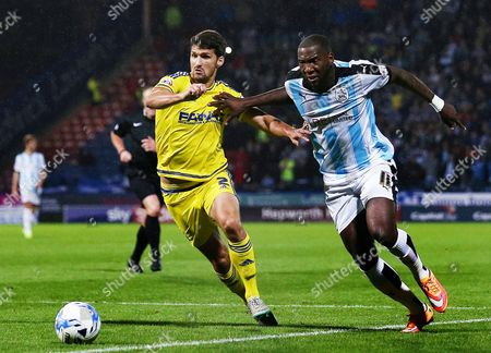 Ishmael Miller of Huddersfield Town and Eric Lichaj of Nottingham Forest during the Sky Bet Championship match between Huddersfield Town and Nottingham Forest played at the John Smith's Stadium, Huddersfield