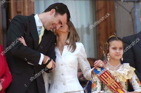 Prince Felipe and Princess Letizia are accompanied by the Fallas Child Queen, Cristina Sanchez, at Valencia City Hall during the second most important day of Fallas celebration