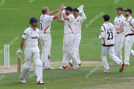 Alastair Cook of Essex (L) leaves the field having been dismissed for 6 from the bowling of Glen Chapple during Essex CCC vs Lancashire CCC, Day Four