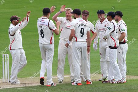 Glen Chapple of Lancashire (C) is congratulated by his team mates after taking the wicket of Alastair Cook during Essex CCC vs Lancashire CCC, Day Four