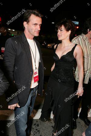 Agent Stephen Huvane and Carla Gugino