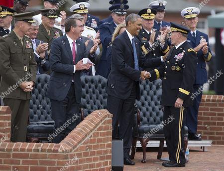 General Joseph Dunford, Defense Secretary Ashton Carter, and US President Barack Obama applaud General Martin Dempsey