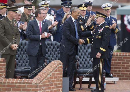 US President Barack Obama congratulates General Martin Dempsey