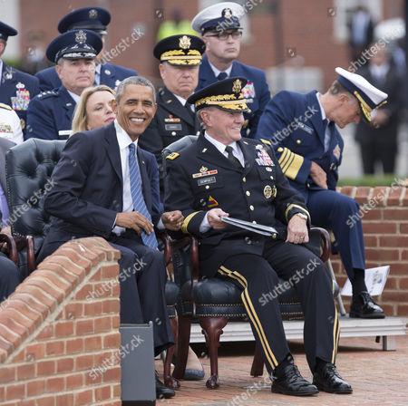 US President Barack Obama speaks with General Martin Dempsey