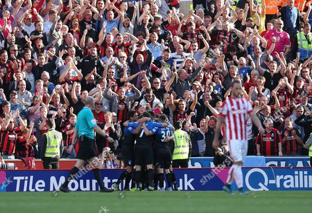 Bournemouth fans celebrate Dan Gosling's equalising goal  during the Barclays Premier league  match between Stoke City and Bournemouth played at The Britannia Stadium