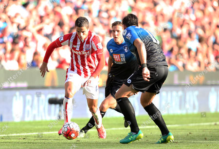 Stoke City's Ibrahim Afellay takes on Bournemouth's Charlie Daniels and Dan Gosling during the Barclays Premier league  match between Stoke City and Bournemouth played at The Britannia Stadium