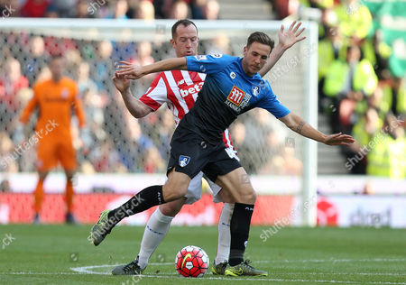 Bournemouth's Dan Gosling holds off Stoke City's Charlie Adamduring the Barclays Premier league  match between Stoke City and Bournemouth played at The Britannia Stadium
