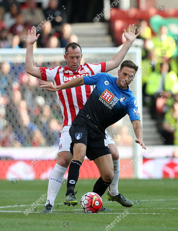 Bournemouth's Dan Gosling holds off Stoke City's Charlie Adam during the Barclays Premier league  match between Stoke City and Bournemouth played at The Britannia Stadium