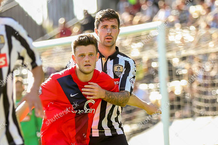Notts County defender Alan Sheehan has a hold of York City forward Reece Thompson during the Sky Bet League 2 match between Notts County and York City at Meadow Lane, Nottingham