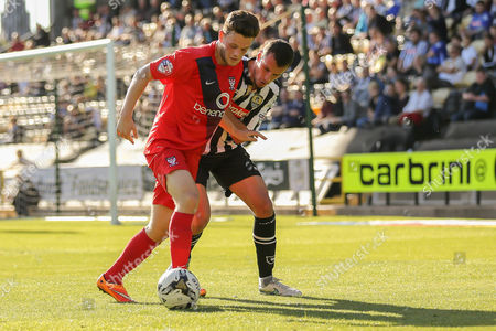 York City forward Reece Thompson shields the ball from Notts County defender Haydn Hollis during the Sky Bet League 2 match between Notts County and York City at Meadow Lane, Nottingham
