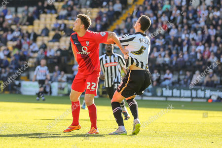 York City forward Reece Thompson has a hold of Notts County defender Haydn Hollis shirt during the Sky Bet League 2 match between Notts County and York City at Meadow Lane, Nottingham