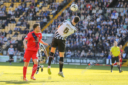 Notts County defender Haydn Hollis heads away from York City forward Reece Thompson during the Sky Bet League 2 match between Notts County and York City at Meadow Lane, Nottingham