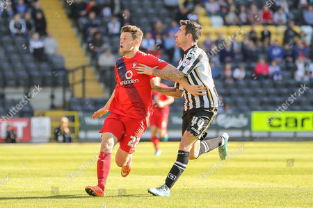 York City forward Reece Thompson battles with Notts County defender Alan Sheehan during the Sky Bet League 2 match between Notts County and York City at Meadow Lane, Nottingham