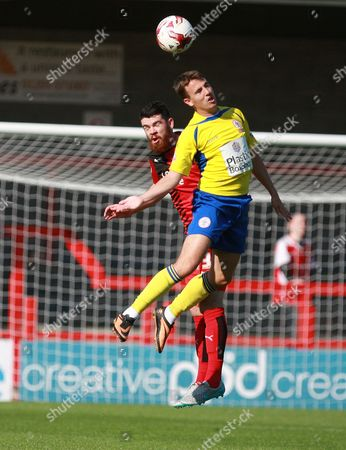 Accrington Stanley midfielder Sean McConville and Crawley Town defender Liam Donnelly compete for a high ball during the Sky Bet League 2 match between Crawley Town and Accrington Stanley at the Checkatrade.com Stadium, Crawley