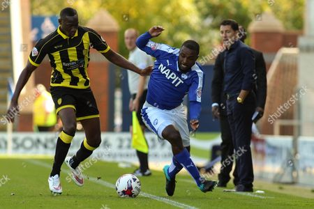 Chesterfield FC manager Dean Saunders looks on as Chesterfield FC forward Sylvan Ebanks-Blake challenges for the ball during the Sky Bet League 1 match between Chesterfield and Burton Albion at the Proact stadium, Chesterfield