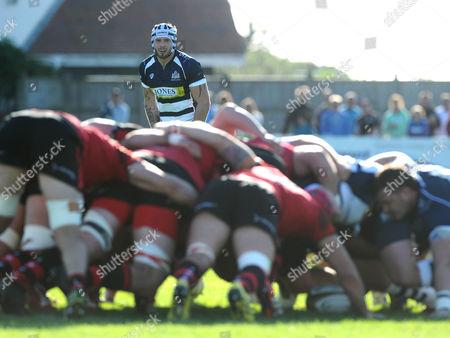 Bristol Rugby Winger Ryan Edwards watches the scrum
