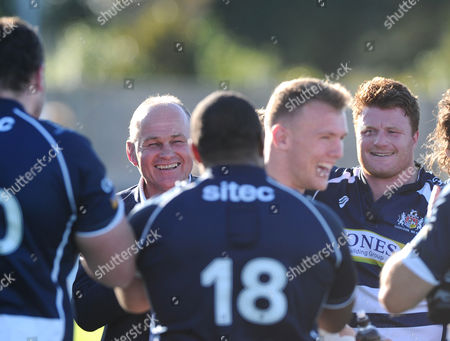 Bristol Rugby Director of Rugby Andy Robinson and Bristol Players congratulate Bristol Rugby Inside Centre Nick Carpenter after the game on his debut