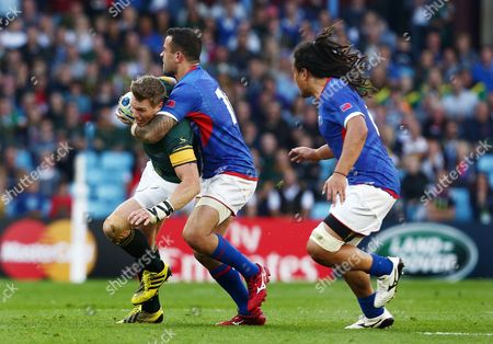 Jean de Villiers of South Africa is tackled by Michael Stanley of Samoa during the IRB Rugby World Cup 2015 Pool B match between South Africa and Samoa played at Villa Park, Birmingham