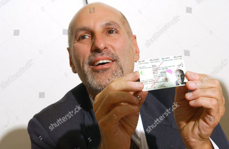Editorial picture of ADOBE PRESENTS ELECTRONIC SIGNATURE HELD ON IDENTITY CARD, BRUSSELS, BELGIUM -  7 APR 2005