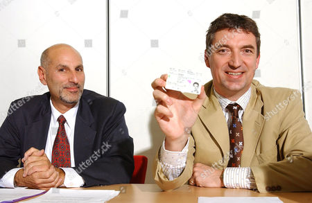 Editorial photo of ADOBE PRESENTS ELECTRONIC SIGNATURE HELD ON IDENTITY CARD, BRUSSELS, BELGIUM -  7 APR 2005