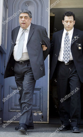 Stock Picture of Vincent Pastore in handcuffs is walked out of the Fifth police Precinct by Detective Steven Wilner after turning himself in, for beating up his girlfriend Lisa Regina.