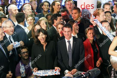 French Prime Minister Manuel Valls (C-R), French Minister for Cities, Youth and Sport Patrick Kanner (3rd R), Mayor of Paris Anne Hidalgo (4th L) and Jean-Paul Huchon (L)