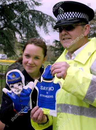 Scarlett Johnson and Inspector Paul Jenkins, Park Police, Finsbury Park, with police puppets warning children about strangers