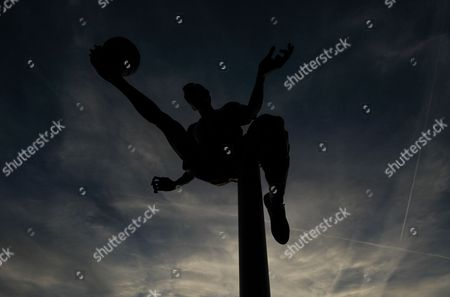 The Dennis Bergkamp statue is silhouetted against the sky before the UEFA Champions League Group F match between Arsenal and Olympiakos played at The Emirates, London on September 29th 2015