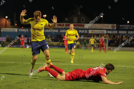 Oxford United defender Johnny Mullins  protests his innocence as York City forward Reece Thompson falls in the box during the Sky Bet League 2 match between York City and Oxford United at Bootham Crescent, York