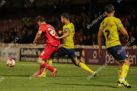 Oxford United defender Jake Wright  has a hold of York City forward Reece Thompson during the Sky Bet League 2 match between York City and Oxford United at Bootham Crescent, York