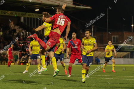 York City defender Dave Winfield climbs with Oxford United defender Johnny Mullins  during the Sky Bet League 2 match between York City and Oxford United at Bootham Crescent, York
