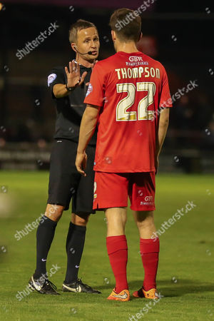 York City forward Reece Thompson gets a lecture from the referee  during the Sky Bet League 2 match between York City and Oxford United at Bootham Crescent, York