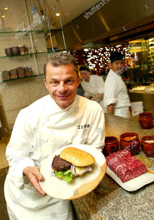 Rainer Becker with the £55 burger. The beef in the 200g burger is Wagyu meat, a strain of the famously succulent beef from Kobe in Japan that first went on sale in Harrods in 2003. The beef comes from New Zealand where the cows are reared on beer and massaged until they weigh three quarters of a ton, more than double the weight of an average cow.