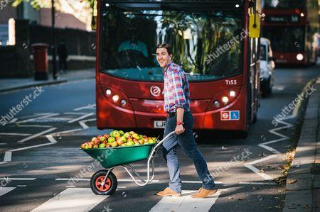 Farmdrop founder Ben Pugh handing out apples
