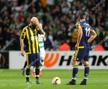 Stock Picture of Raul Meireles of Fenerbache (left) and Robin van Persie of Fenerbache are dejected after conceding a goal during the UEFA Europa League Group A match between Celtic and Fenerbache played at Celtic Park, Glasgow