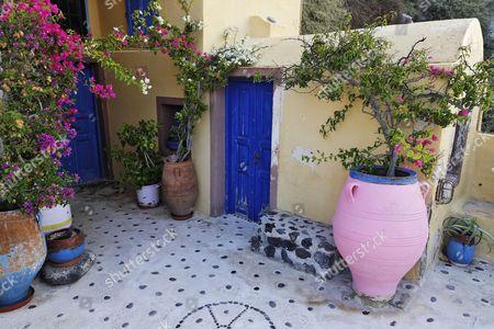A colourful yard of a house, Oia, Santorini, Greece