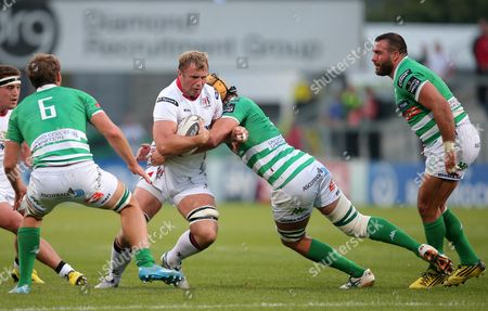 Ulster's Roger Wilson is tackled by Treviso's Tom Palmer