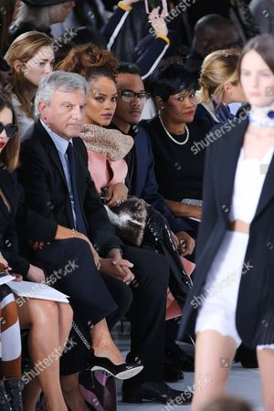 Sidney Toledano (left), Rihanna (second left), her brother Rajad Fenty (second right) and and her mother Monica Fenty (right) in the front row