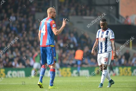 Brede Hangeland of Crystal Palace alongside Saido Berahino of West Bromwich Albion during the Barclays Premier League match between Crystal Palace and West Bromwich Albion played at Selhurst Park, London on October 3rd 2015