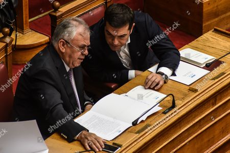 Prime Minister Alexis Tsipras and Alternate PM Yannis Dragasakis during swearing in of the 300 lawmakers of the eight parties that were elected in the Greek national elections of September 20 2015 At Parliament in Athens, on Saturday, October 3, 2015