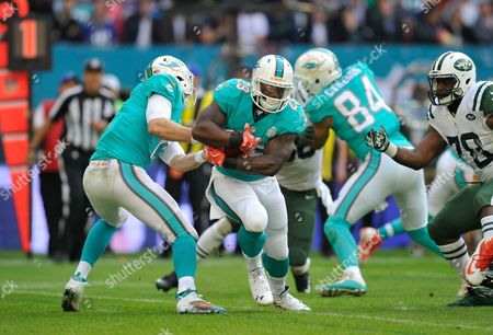 Ryan Tannehill (17) hands off to Jonas Gray (29) during the NFL Week 4 game between Miami Dolphins and New York Jets played at Wembley Stadium, London on October 4th 2015