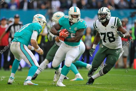 Jonas Gray (29) and Leger Douzable (78) during the NFL Week 4 game between Miami Dolphins and New York Jets played at Wembley Stadium, London on October 4th 2015
