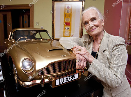 Stock Image of Goldfinger 50th Anniversary Auction Hosted By Chisties Which Is Raising Money For Nspcc Taking Place In London. Shirley Eaton Who Was One Of The Bond Girls With A Gold Plated Aston Martin That Is Being Auctioned. 17.9.14