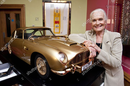 Goldfinger 50th Anniversary Auction Hosted By Chisties Which Is Raising Money For Nspcc Taking Place In London. Shirley Eaton Who Was One Of The Bond Girls With A Gold Plated Aston Martin That Is Being Auctioned. 17.9.14