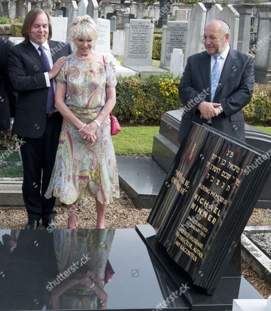 Stone Designer Crispian Sallis With Geraldine Winner Gather For The Unveiling Of A Headstone Of Film Director Michael Winner At The Jewish Cemetery In Willesden. 19.09.14. Reporter Tania Steer.