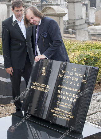 Crispian Sallis Designer Of The Stone Joins Family And Friends Including Geraldine Winner And Michael Parkinson For The Unveiling Of The Headstone Of Film Director Michael Winner At The Jewish Cemetery In Willesden North London. 19.09.14. Reporter Tania Steer.