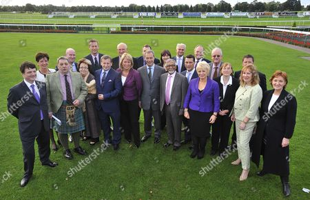 Ukip Annual Party Conference At Doncaster Racecourse South Yorkshire. Pic Shows:- Ukip Leader Nigel Farage Poses For A Group Photograph With His Ukip Mep's At Doncaster Racecourse. (l-r):- Gerrard Batten Diane James David Coburn Paul Nuttall Margo Parker Nathan Gill Ray Finch Stuart Agnew Jill Seymour Johnathan Arnett Nigel Farage Louise Bours Amjad Bashir Patrick O'flynn Steven Woolfe William Dartmouth Jane Collins Roger Helmer Julia Reed Mike Hookem Jane Atkinson And Ukip Dep.ch. Suzanne Evans.