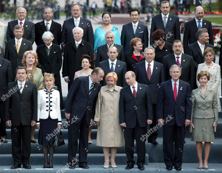 Over 50 world leaders gathered for a photograph. Front Row - Gerhard Schroeder, Doris Schroeder, Jacques Chirac, Lyudmila Putina, Vladimir Putin, George W. Bush with his wife Laura Bush.
